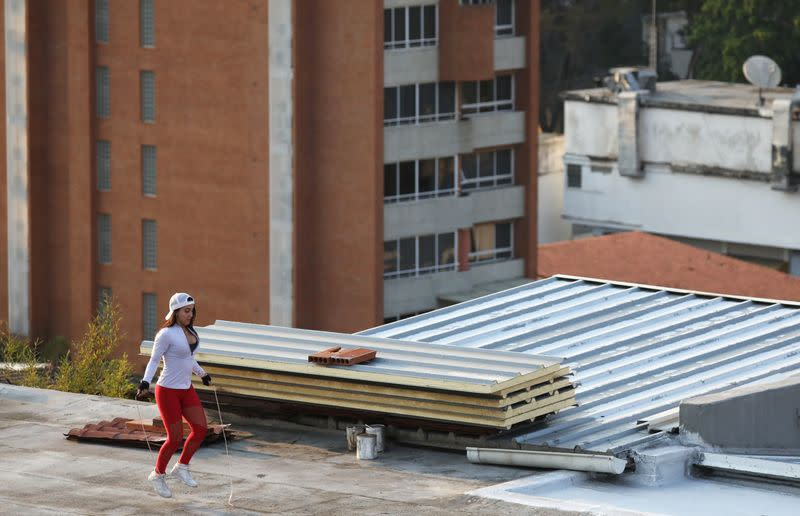 A woman jumps rope at a rooftop during a nationwide quarantine due to the coronavirus disease (COVID-19) outbreak in Caracas