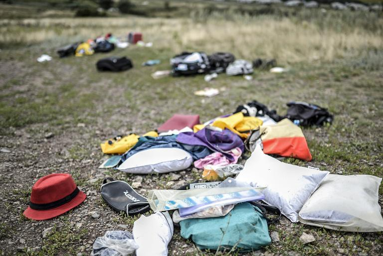Belongings are scattered at the crash site of a Malaysia Airlines plane in Grabove on July 20, 2014
