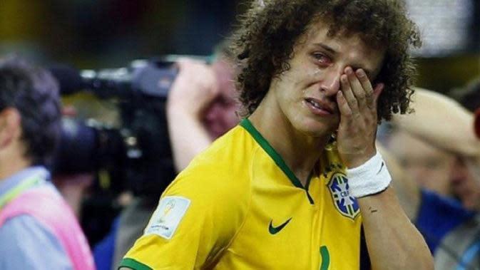 Ekspresi David Luiz usai Brasil dipermalukan Jerman 7-1 pada semifinal Piala Dunia 2014. (Dok)