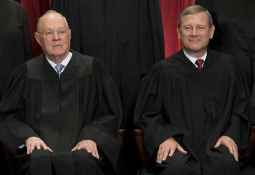 US Supreme Court Justice Anthony Kennedy (L), pictured in 2017 with Chief Justice John Roberts, was long a swing vote on the nine-member top court