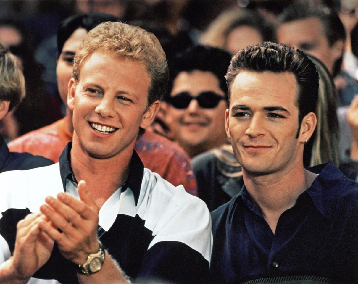 """<p>Perry (right) was best known for playing Dylan McKay, originally the boyfriend of Shannen Doherty's central character, Brenda Walsh, in the phenomenally popular '90s teen show — in one of his very first roles. As McKay, he played a James Dean-type loner with a troubled family life and won the hearts of teenage girls everywhere. In 1992, <a rel=""""nofollow"""" href=""""https://people.com/archive/cover-story-down-and-out-not-in-beverly-hills-vol-36-no-17/""""><i>People</i></a> magazine noted that he once climbed into a laundry hamper to escape 4,000 screaming fans. Though he left the show in 1995, he just couldn't stay away, and returned in 1998 for its final two seasons. (Photo: Everett Collection) </p>"""