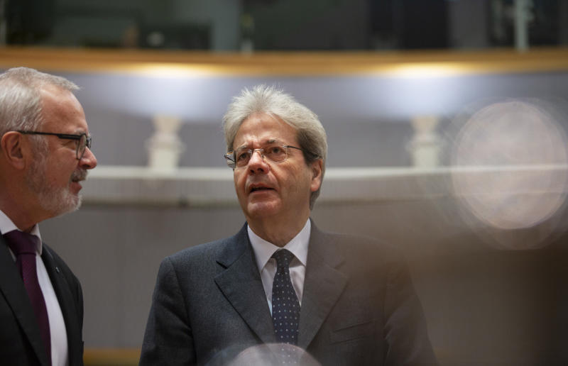 European Commissioner for Economy Paolo Gentiloni, right, speaks with President of the European Investment Bank Werner Hoyer during a meeting of EU finance ministers at the Europa building in Brussels, Tuesday, Feb. 18, 2020. EU finance ministers meet Tuesday to discuss tax havens. (AP Photo/Virginia Mayo)