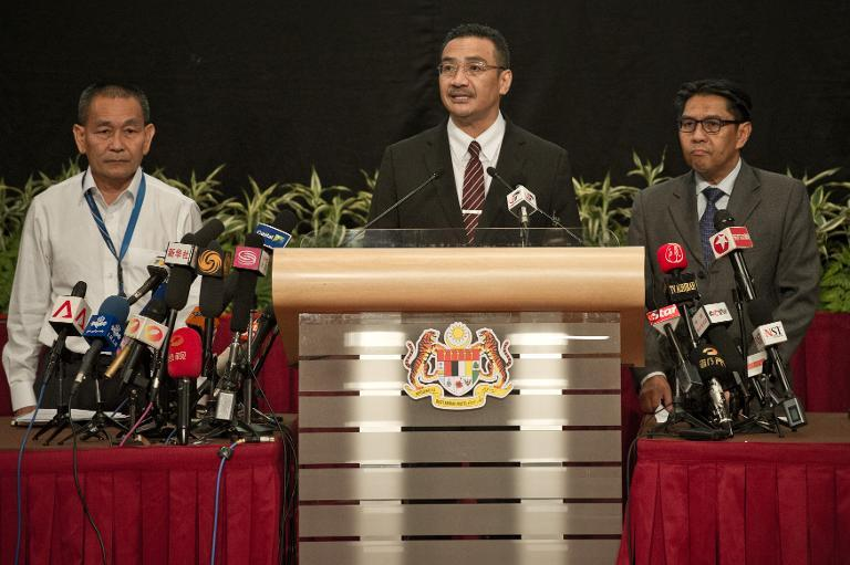 Malaysia's Transport Minister Hishammuddin Hussein (centre) answers questions during a press conference in Kuala Lumpur, on March 24, 2014