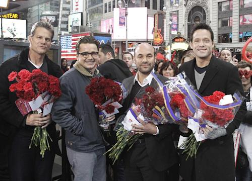 """In this image released by ABC, actors from left, Brian Van Holt, Dan Byrd, Ian Gomez and Josh Hopkins, from the comedy series """"Cougar Town,"""" pose before distributing carnations on Valentine's Day while appearing on """"Good Morning America,"""" Tuesday, Feb. 14, 2012 in New York. The hit comedy series returns for a third season Tuesday at 8:30p.m. EST on ABC. (AP Photo/ABC, Lou Rocco)"""