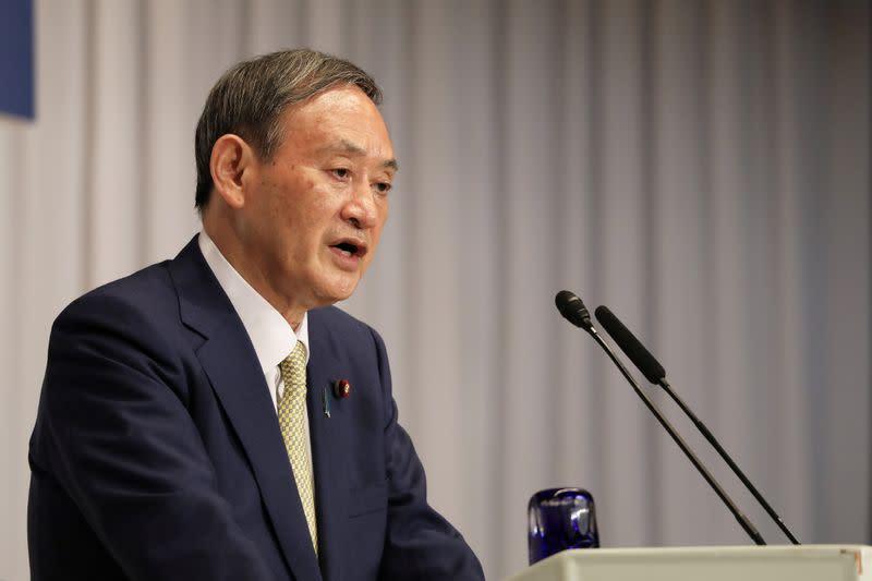 Japan's Suga says coronavirus will take priority in deciding on snap election