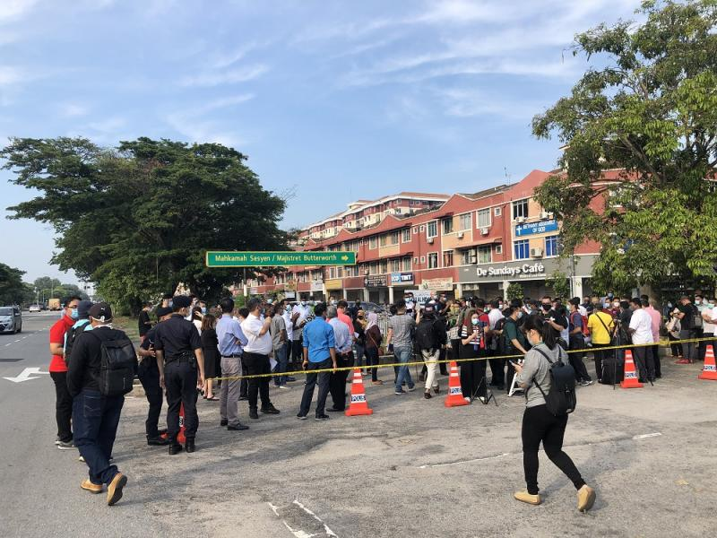 Media personnel and Lim Guan Eng's supporters are gathered in loose groups outside the Butterworth courthouse at 9am August 10, 2020. — Picture by Opalyn Mok