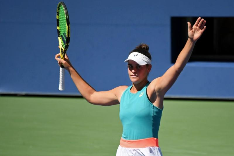 Brady routs Putintseva to reach U.S. Open semi-finals