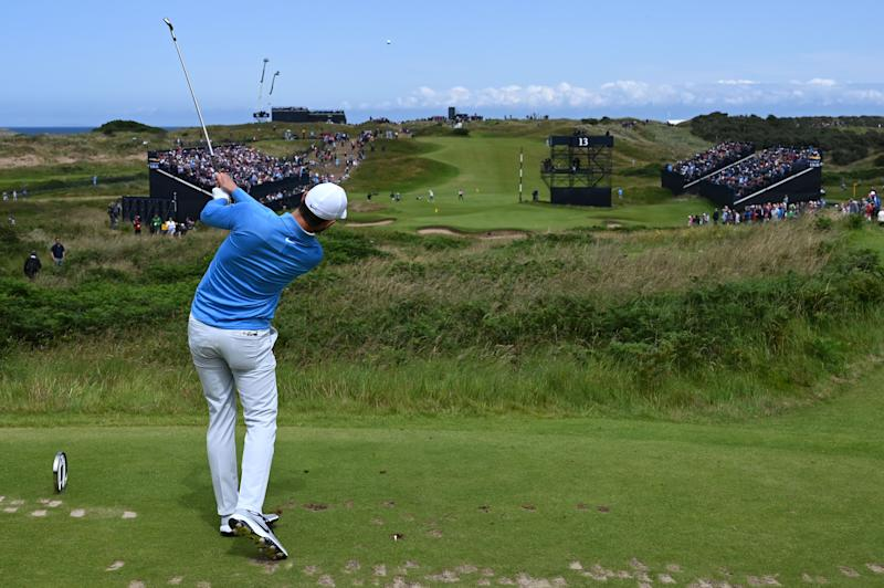 US golfer Kyle Stanley tees off from the 13th hole during the third round of the British Open golf Championships at Royal Portrush golf club in Northern Ireland on July 20, 2019. (Photo by Paul ELLIS / AFP) / RESTRICTED TO EDITORIAL USE (Photo credit should read PAUL ELLIS/AFP/Getty Images)