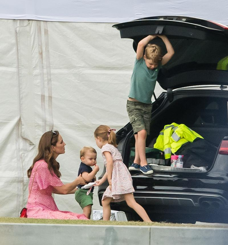 Catherine, Duchess of Cambridge, pictured playing with Prince Louis, Prince George and Princess Charlotte