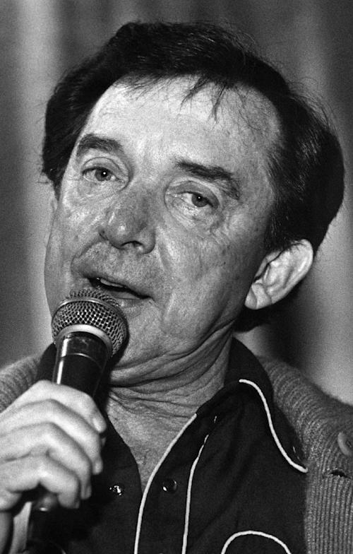 FILE - In this March 13, 1981, file photo, country music singer Ray Price, performs in Nashville, Tenn. Price, one of country music's most popular and influential singers and bandleaders who had more than 100 hits and was one of the last living connections to Hank Williams, died Monday, Dec. 16, 2013. He was 87. (AP Photo/File)