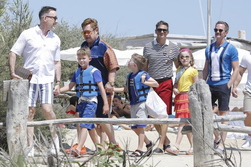 Elton John, David Furnish and kids Harper and Gideon, Neil Patrick Harris and David Burtka and children Zachary and Elijah arrive at Le Club 55 restaurant in Saint-Tropez on August 2nd. Photo: Spread Pictures / MEGA