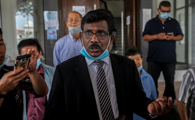 Lawyer K. Kunasekaran, who represented three farmers from Kuala Kuang, Chemor on the land eviction issue, speaks to reporters outside the High Court in Ipoh July 2, 2020. ― Picture by Farhan Najib