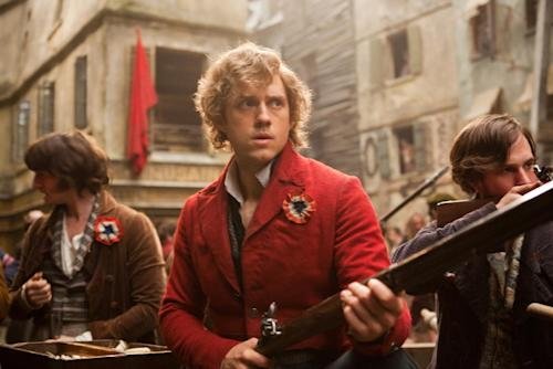 "This film image released by Universal Pictures shows Aaron Tveit as Enjolras, center, in a scene from ""Les Miserables."" (AP Photo/Universal Pictures, Laurie Sparham)"