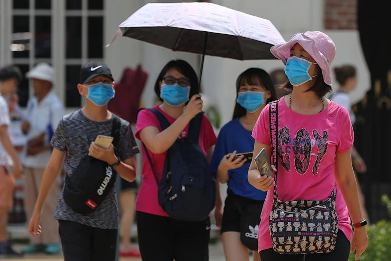 Chinese tourists wearing protective face masks are seen at the Dataran Merdeka in Kuala Lumpur January 28, 2020. — Picture by Yusof Mat Isa