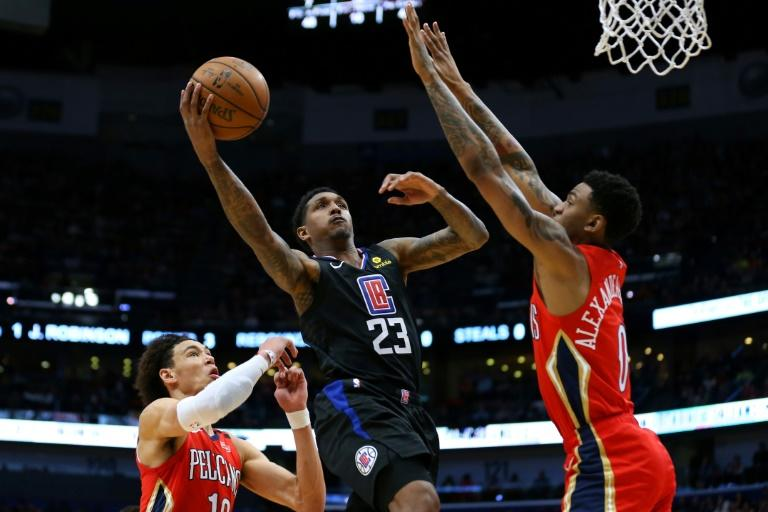 Lou Williams of the LA Clippers shoots against Nickeil Alexander-Walker in a 133-130 NBA victory over the New Orleans Pelicans