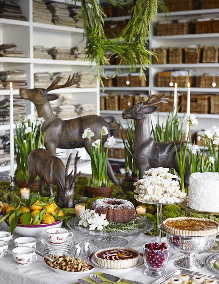 <p>If you opt for a buffet display table, go big with decorations. Deer or elk make for a fun and whimsical display and can be utilized with a variety of heights, greenery, and creative objects.</p>