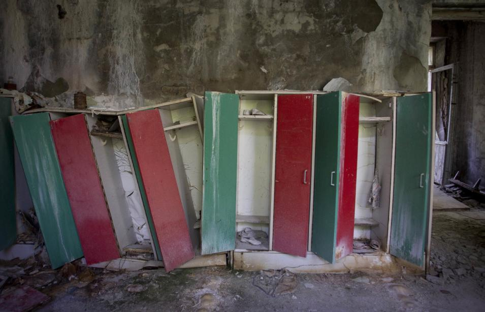 This June 8, 2011 photo shows dilapidated shelves in a dressing room of a kindergarten at the deserted town of Pripyat, Ukraine, some 3 kilometers (1.86 miles) from the Chernobyl nuclear plant. Chernobyl and Fukushima are some 5,000 miles apart but have much in common. The towns nearest to each of these stricken nuclear power stations, in Ukraine and Japan, whose disasters struck 25 years apart, already reveal eerie similarities. (AP Photo/Sergey Ponomarev) ONE OF PAIR NO. 5