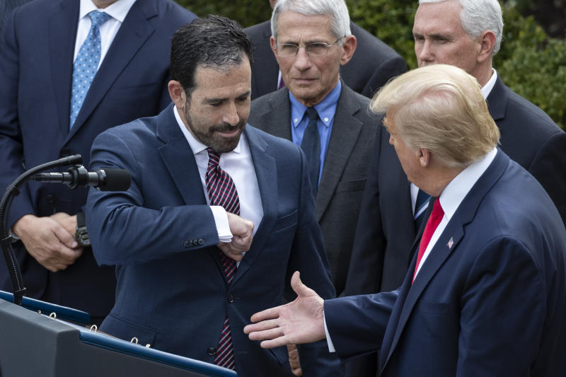 LHC Group's Bruce Greenstein elbow bumps with President Donald Trump during a news conference about the coronavirus in the Rose Garden at the White House, Friday, March 13, 2020, in Washington. (AP Photo/Alex Brandon)