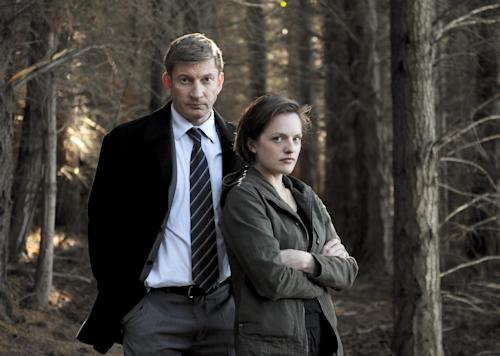 "This undated publicity image released by Sundance Channel shows David Wenham, left, and Elisabeth Moss in the Sundance Channel original miniseries ""Top of the Lake"". Moss was nominated for an Emmy Award for best actress in a miniseries or movie on Thursday July 18, 2013. The program was also nominated for outstanding movie or miniseries.The Academy of Television Arts & Sciences' Emmy ceremony will be hosted by Neil Patrick Harris. It will air Sept. 22 on CBS. (AP Photo/Sundance Channel, Parisa Taghizadeh)"