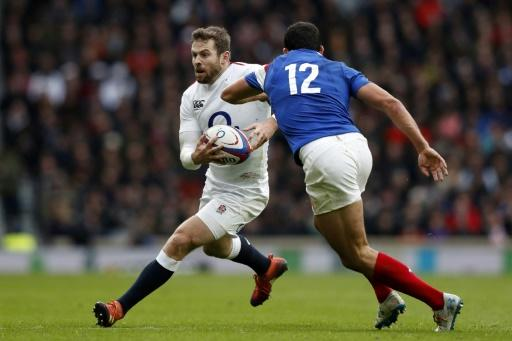 Daly run: England full-back Elliot Daly (L) on the attack against  Geoffrey Doumayrou (R) during a 44-8 win over France in the Six Nations at Twickenham on Sunday
