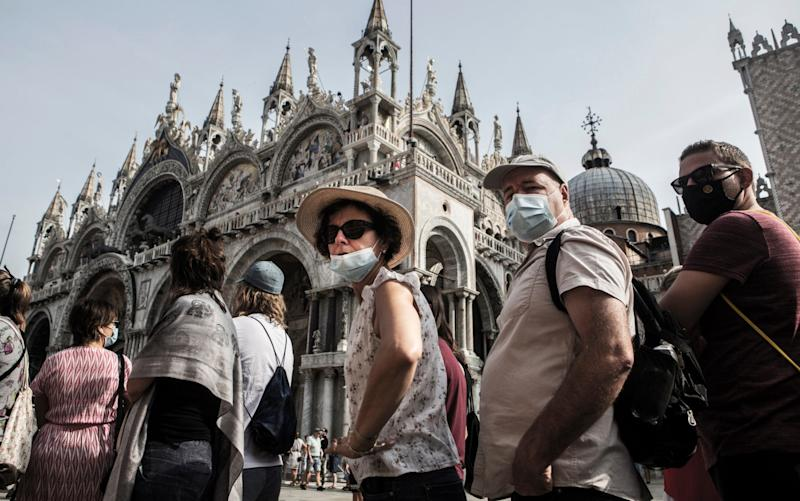 Tourists queue outside San Marco Basilica, on September 10, 2020 in Venice, Italy - Corbis News