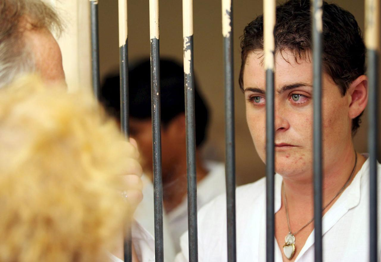<p>The 41-year-old speaks to her father from behind bars after her sentencing hearingat the Indonesian prison in 2006. Photo: AAP </p>