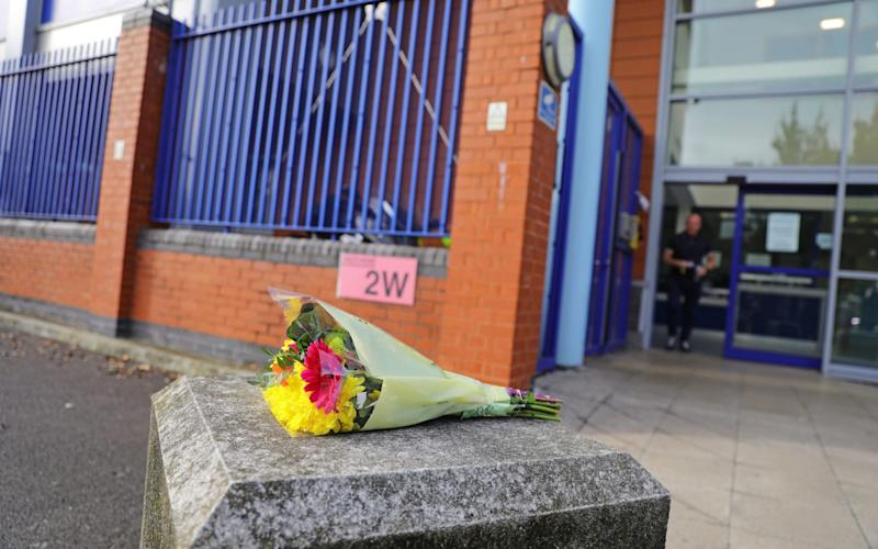Flowers left outside Croydon Custody Centre - Aaron Chown/PA