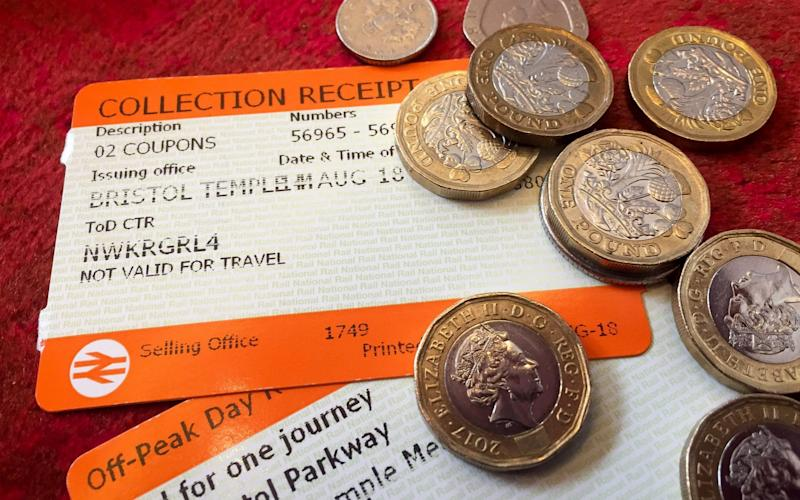 Rail ticket and pound coins - PA