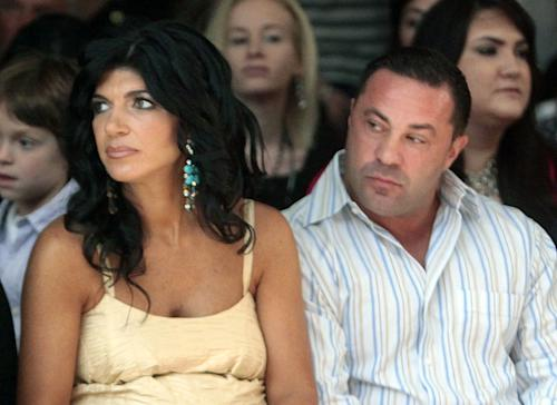 "FILE - This Sept. 13, 2009 file photo originally released by Oral-B Pulsonic shows ""Real Housewives of New Jersey"" stars, Teresa Giudice, left, and her husband Joe Giudice at the Caravan Fashion Show sponsored by Oral-B Pulsonic in New York. Teresa and Giuseppe ""Joe"" Giudice were charged in a 39-count indictment handed up Monday, July 29, 2013, in Newark, N.J. The two are accused of submitting fraudulent mortgage and other loan applications from 2001 through 2008, a year before their show debuted on Bravo. Prosecutors say they made false claims about their employment status and salaries. (AP Photo/Oral-B Pulsonic, Gary He)"