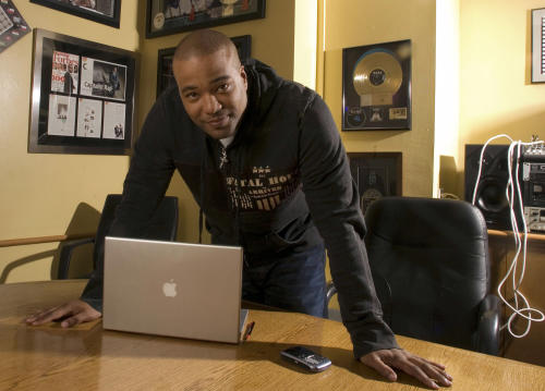 FILE - This Feb. 28, 2007 file photo shows hip-hop mogul Chris Lighty in his office in New York. Lightly died of an apparent gunshot wound on Thursday, Aug. 30, 2012 at his home in the Bronx borough of New York. He was 44. Lighty was the man behind rapís leading figures, helping them not only attain hit records, but lucrative careers outside of music. He had been a part of the rap scene for decades, working with pioneers like LL Cool J, KRS-One before starting his own management company, Violator. (AP Photo/Jim Cooper, file)