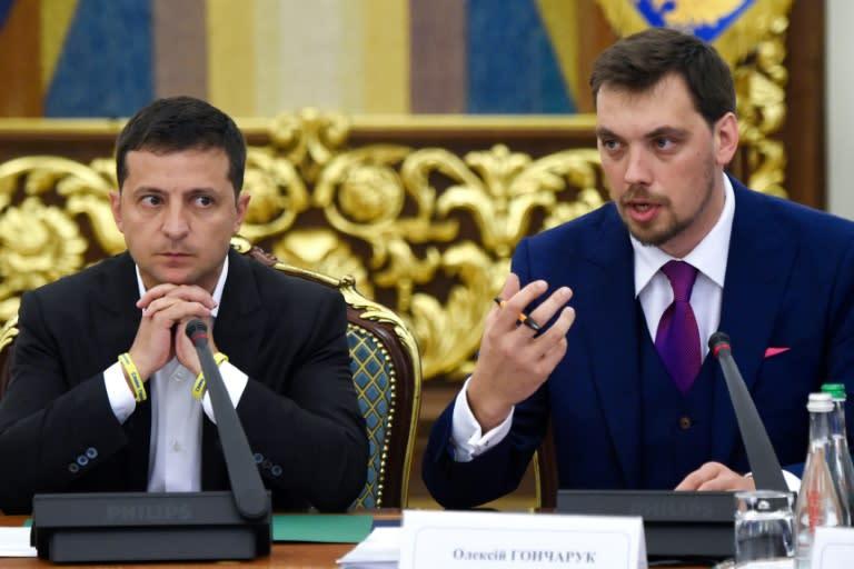 Ukraine President Volodymyr Zelensky, left, rejected the resignation of his Prime Minister Oleksiy Goncharuk over a leaked recording scandal