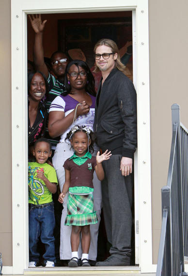 "Brad Pitt visits a family staying in a house rebuilt by his ""Make It Right Foundation"" in New Orleans"