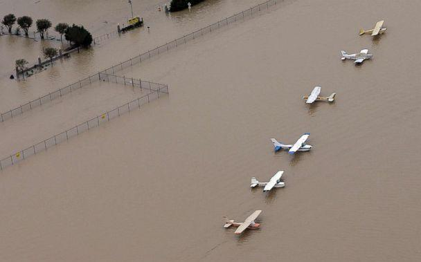 PHOTO: Airplanes sit at a flooded airport near the Addicks Reservoir as floodwaters from Tropical Storm Harvey rise, Aug. 29, 2017, in Houston, Texas. (David J. Phillip/AP)