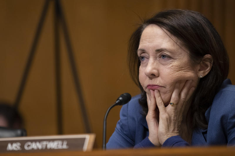 """Sen. Maria Cantwell, D-Wash., questions Treasury Secretary Steve Mnuchin as he testifies during a hearing of the Senate Finance Committee hearing on """"The President's Fiscal Year 2021 Budget,"""" on Capitol Hill, Wednesday, Feb. 12, 2020, in Washington. (AP Photo/Alex Brandon)"""