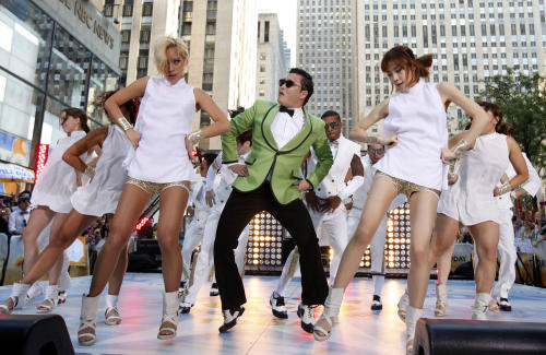 "In this photo taken on Sept. 14, 2012, South Korean rapper PSY performs his massive K-pop hit ""Gangnam Style"" live on NBC's ""Today"" show in New York. His ""Gangnam Style"" video has more than 200 million YouTube views and counting, and it's easy to see why. Gangnam is only a small slice of Seoul, but it inspires a complicated mixture of desire, envy and bitterness. It's also the spark for PSY's catchy, world-conquering song. (AP Photo/Invision via AP Images, Jason DeCrow)"