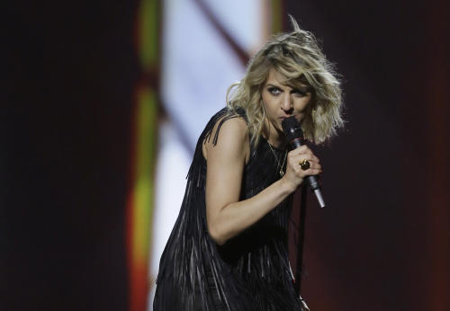 Amandine Bougeois of France performs her song L'Enfer et Moi (Hell and Me) during a rehearsal for the final of the Eurovision Song Contest at the Malmo Arena in Malmo, Sweden, Friday, May 17, 2013. The contest is run by European television broadcasters with the event being held in Sweden as they won the competition in 2012, the final will be held in Malmo on May 18. (AP Photo/Alastair Grant)