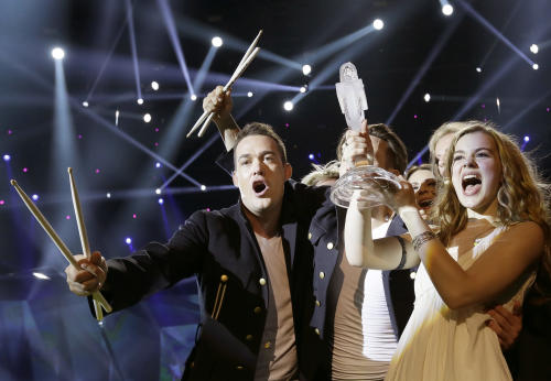 "Winner of the 2013 Eurovision Song Contest Emmelie de Forest of Denmark who sang ""Only Teardrops,"" celebrates with the trophy after the final at the Malmo Arena in Malmo, Sweden, Saturday, May 18, 2013. The contest is run by European television broadcasters with the event being held in Sweden as they won the competition in 2012. (AP Photo/Alastair Grant)"