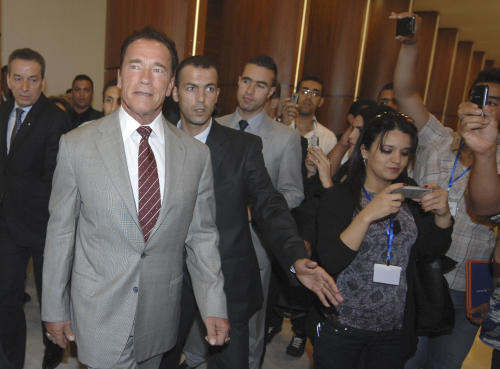 Former California Governor Arnold Schwarzenegger, now president of NGO R20, leaves after a press conference in Algiers, Tuesday, June 25, 2013. Schwarzenegger founded R20, a coalition of partners led by regional governments that work to promote and implement projects that are designed to produce local economic and environmental benefits in the form of reduced energy consumption and greenhouse gas emissions. The R20 will open an office in Algeria.(AP Photo/Sidali Djarboub)