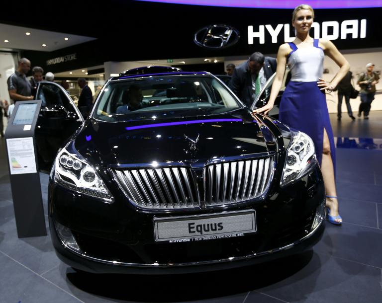 Model poses next to Hyundai Equus car at Frankfurt Motor Show