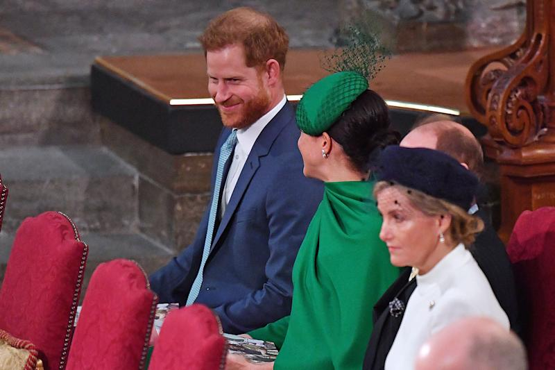 Britain's Prince Harry, Duke of Sussex (L) sits beside his wife Britain's Meghan, Duchess of Sussex (C) inside Westminster Abbey as they attend the annual Commonwealth Service in London on March 9, 2020. - Britain's Queen Elizabeth II has been the Head of the Commonwealth throughout her reign. Organised by the Royal Commonwealth Society, the Service is the largest annual inter-faith gathering in the United Kingdom. (Photo by Phil HARRIS / POOL / AFP) (Photo by PHIL HARRIS/POOL/AFP via Getty Images)