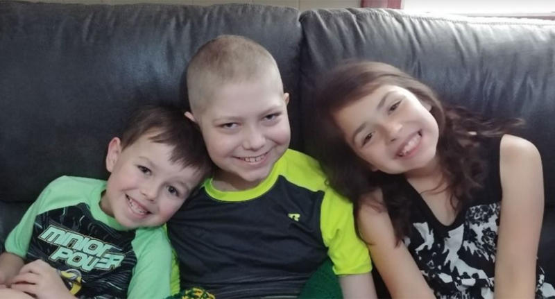 Caleb Hammond (pictured with siblings), suffers from leukemia and has loved car racing since he was 2-years-old and is collecting racing stickers for his casket
