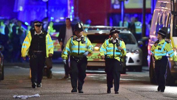 PHOTO: Police officers gather on Borough High Street as police deal with an incident on London Bridge in London, Saturday, June 3, 2017. (Dominic Lipinski/PA via AP)