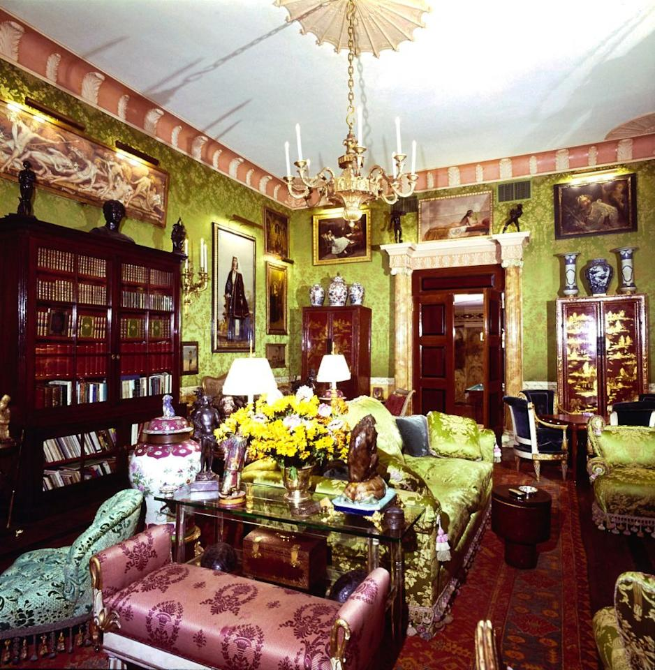 <p>An ornate chartreuse silk damask provides an elegant backdrop for an enviable collection of paintings and objets d'art at the New York apartment of interior designers Robert Denning and Vincent Fourcade from 1977.</p>