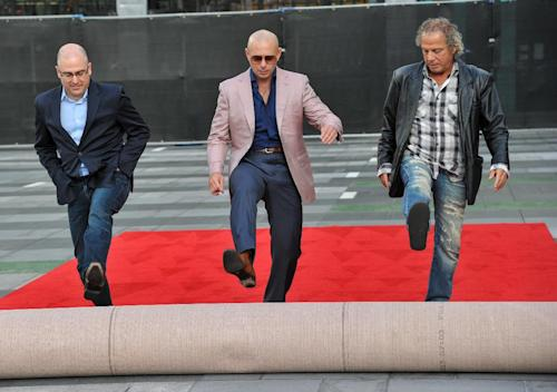 Mark Bracco, ABC's VP of alternative series and specials, from left, host Pitbull, and music producer Larry Klein attend the 2013 American Music Awards Red Carpet Rollout and Press Preview Day, Wednesday, Nov., 20, 2013, at the Nokia Theatre L.A. Live in Los Angeles. The awards will be held on Sunday. (Photo by Richard Shotwell/Invision/AP)