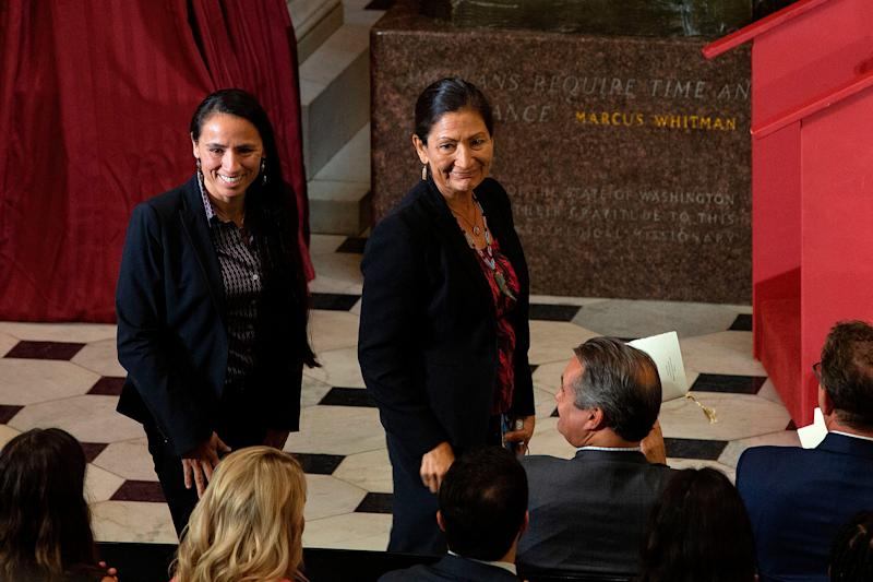 U.S. Representatives Sharice Davids, left, and Deb Haaland are recognized as the first Native American women elected to Congress during a dedication and unveiling ceremony for a statue of Ponca Chief Standing Bear of Nebraska on Capitol Hill in Washington, DC, on Sept. 18, 2019. | Alastair Pike— AFP/Getty Images