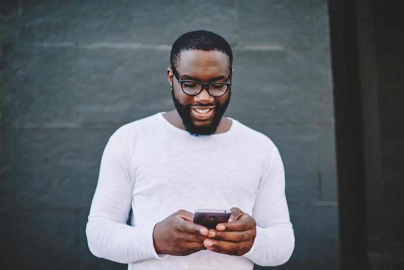 man texting on smartphone, relationship white lies