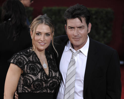 FILE - In this Sunday, Sept. 20, 2009 photo, actor Charlie Sheen, right, and wife Brooke Mueller arrive at the 61st Primetime Emmy Awards in Los Angeles. Sheen said Friday, May 3, 2013, that he supports a decision by child protective services to temporarily place his twin sons with former wife, Mueller, with the actor's other ex-wife, Denise Richards. (AP Photo/Chris Pizzello, File)