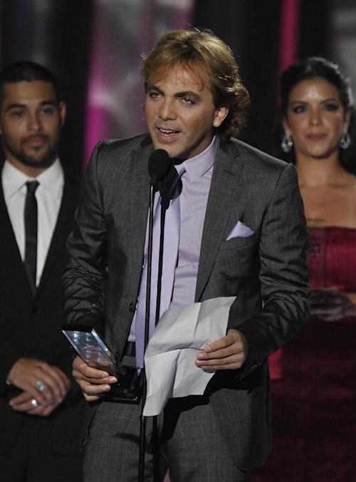 Cristian Castro accepts the Album of the Year award by a male artist during the Latin Billboard Awards in Coral Gables, Fla., Thursday April 26, 2012. (AP Photo/Lynne Sladky)