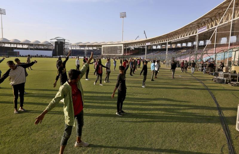 In this Monday, Feb. 17, 2020, photo, performers participate in rehearsal for opening ceremony of Pakistan Super League at National stadium in Karachi, Pakistan. Security concerns stopped foreign cricketers from touring Pakistan four years ago when the country's premier domestic Twenty20 tournament was launched, forcing organizers to stage the event on neutral turf in the United Arab Emirates. When the 2020 edition of the PSL starts in Karachi on Thursday, Darren Sammy of the West Indies and Shane Watson of Australia will be among 36 foreign cricketers involved in the six franchises. (AP Photo/Fareed Khan)