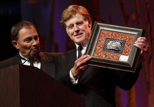 From left: Governor Gary Herbert presents Robert Redford a gift for all his contributions to the state of Utah Saturday Nov. 9, 2013. Redford was recognized and honored by Governor Gary Herbert at a gala in his honor, Saturday, Nov. 9, 2013. (AP Photo/The Salt Lake Tribune, Leah Hogsten)